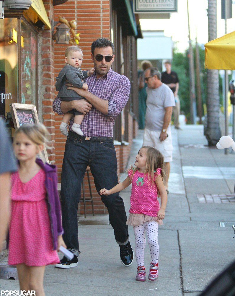 Ben Affleck carried baby Samuel while he chatted with Seraphina October 2012 in Brentwood.