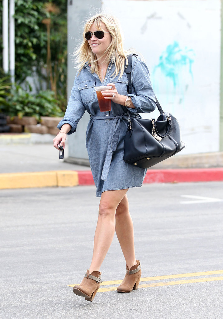 Reese Witherspoon wore a denim dress and Rag & Bone booties.