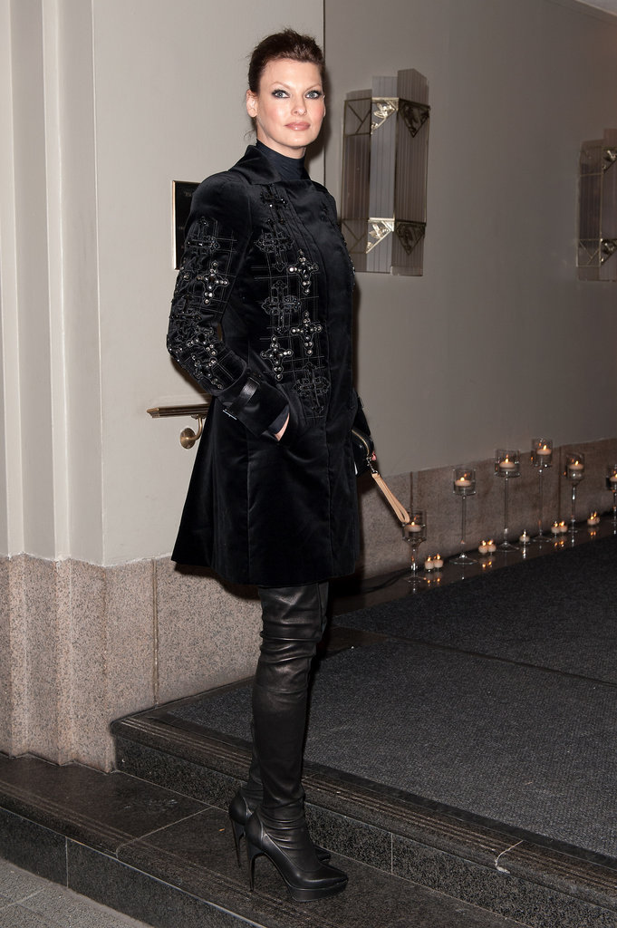 Linda Evangelista styled up her Versace with a pair of thigh-high boots.