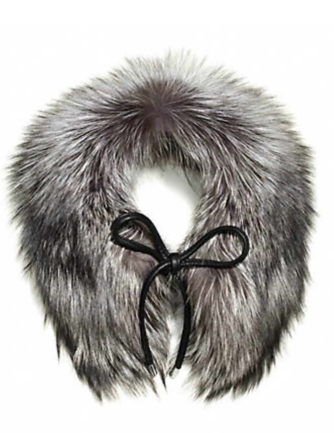 The leather tie lends a modern touch to this Coach Silver Fox Fur Tie Scarf ($598).