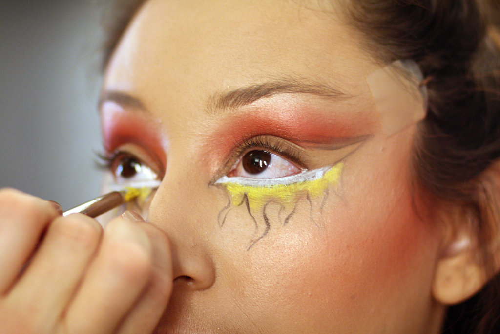 Here's where the right tools make all the difference. To create the look of fire, Zizzo reached for Chromaline. The pro-only product is waterproof and sweatproof —perfect for Halloween. For precise application, Zizzo used the angled 266 brush to apply white Chromaline, then chose the 219 pencil brush to start filling in the flames with Primary Yellow.