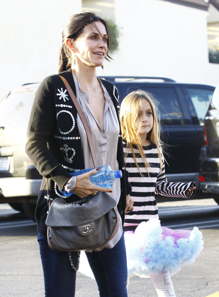 Courteney Cox flashed a smile with Coco Arquette.