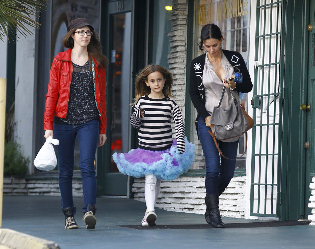 Courteney Cox walked with Coco Arquette and a friend.