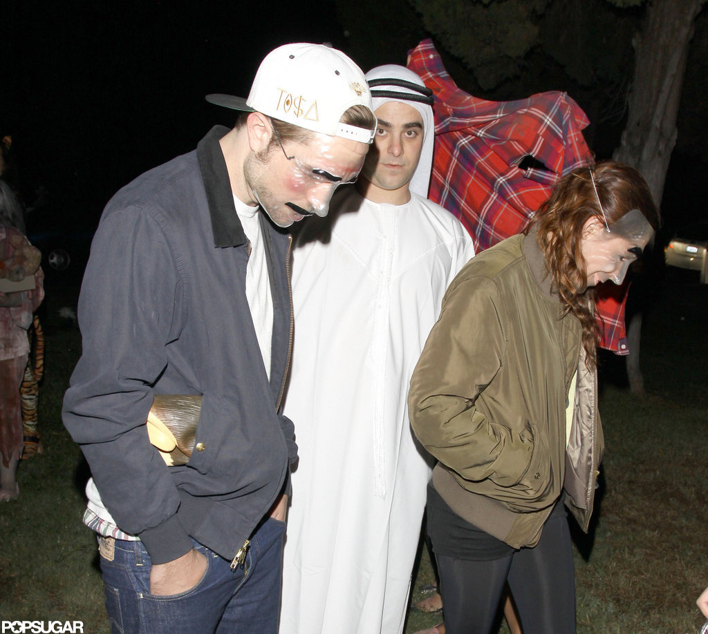 Robert Pattinson and Kristen Stewart wore masks to celebrate at Hollywood Forever Cemetery in 2012.