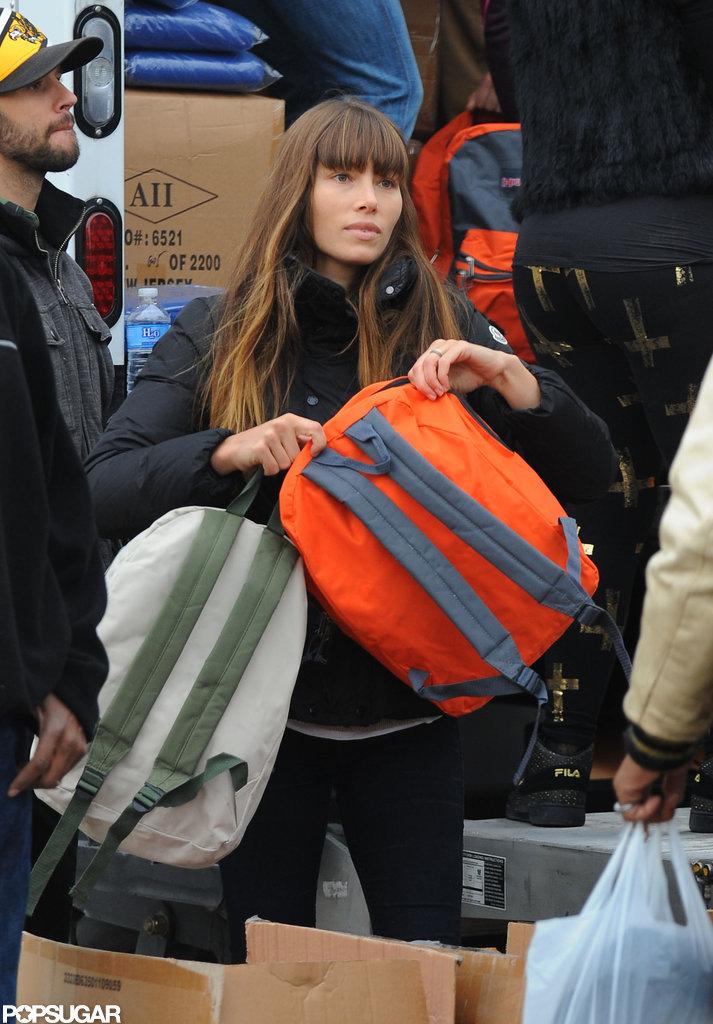 Jessica Biel handed out backpacks.