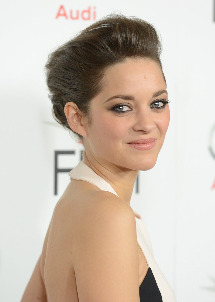 The halter-neck detail adds a slightly sporty touch to her look, while an elegant updo and smoky eyes inject drama.