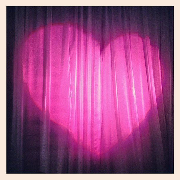 Miranda Kerr captured a photo of the heart-shaped light backstage.  Source: Instagram user mirandakerrverified