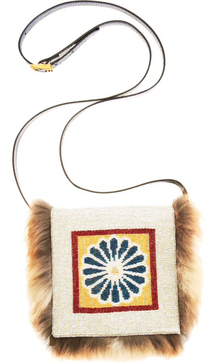 If I was the lucky recipient of this magnificent beaded Fendi Daisy clutch ($2,270), I would wear it with anything; jeans, dresses, gowns, — you name it. This is indeed a wish list right? — Chi Diem Chau, associate editor