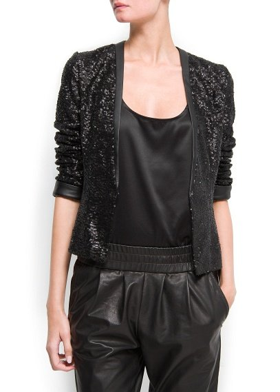 We love the dramatic feel of Mango's Sequined Jacket ($130) for amping up an all-black look, or as a contrast to a pretty jewel toned