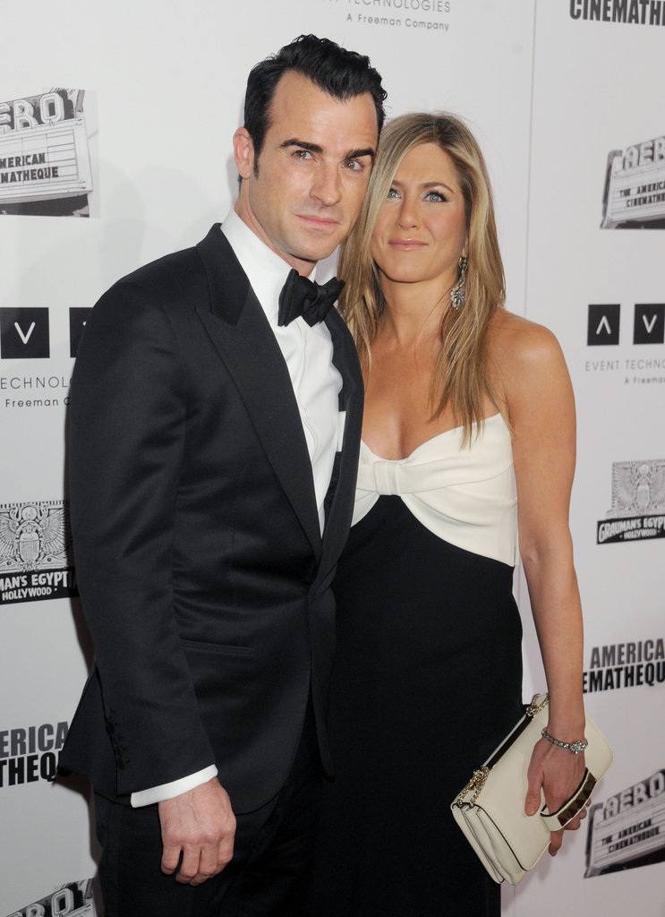 Jennifer Aniston took photos with fiancé Justin Theroux in LA.
