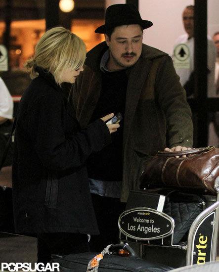 Carey Mulligan and husband Marcus Mumford arrived at LAX.