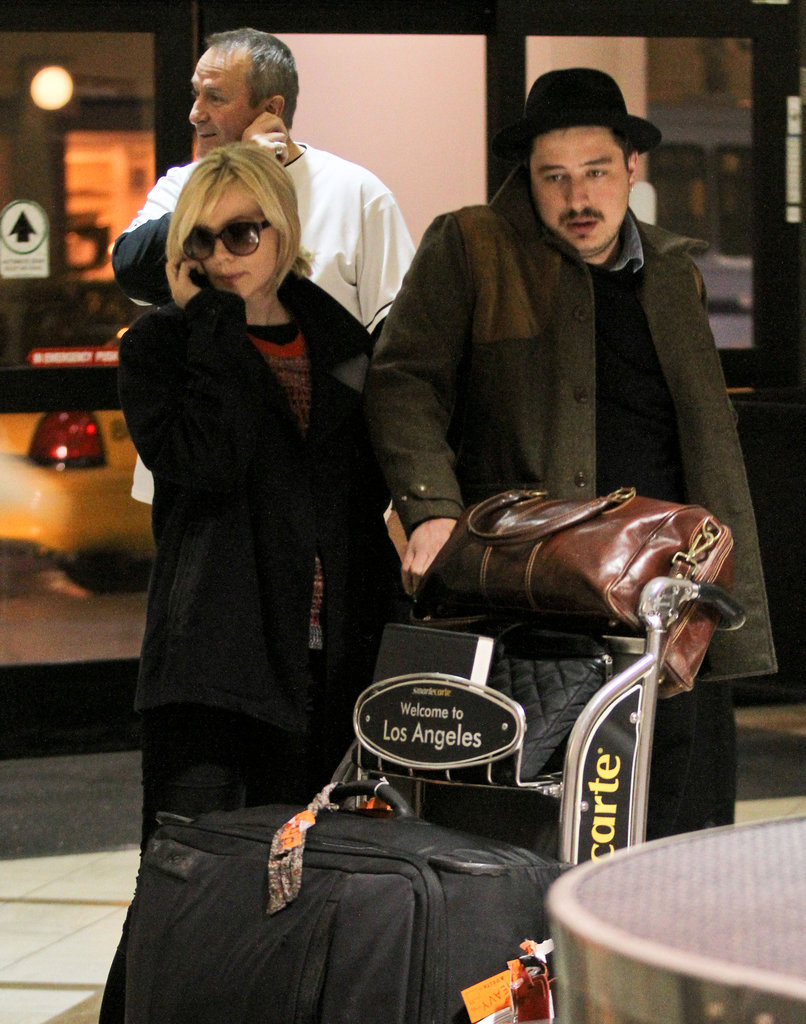 Carey Mulligan and her new husband Marcus Mumford (of band Marcus & Sons) arrived at LAX on November 19.