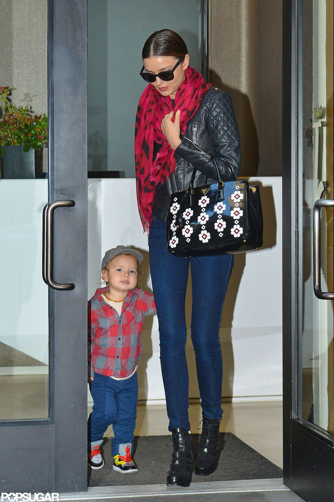 Miranda Kerr left a building in NYC with Flynn Bloom.