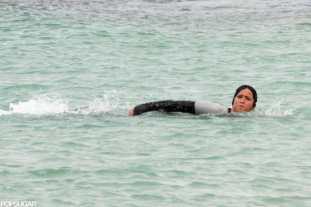 Jennifer Lawrence swam in the ocean while filming scenes for Catching Fire in Hawaii.