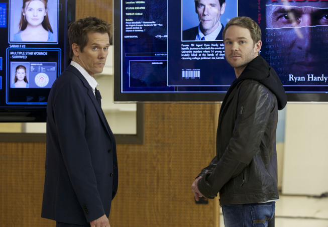 Kevin Bacon as Ryan Hardy and Shawn Ashmore as Agent Mike Weston in The Following.