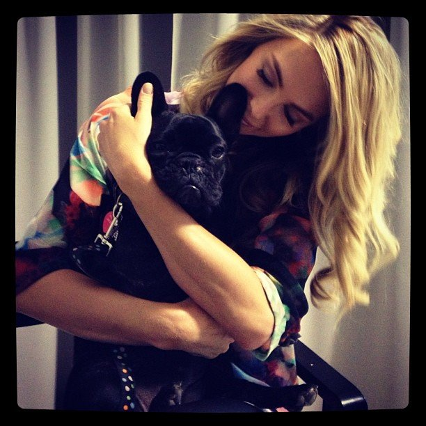 Jennifer Hawkins cuddled up to a furry friend on a recent shoot. Source: Instagram user jenhawkins_