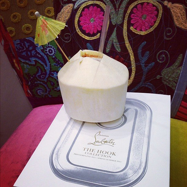 Don't mind if we do! A little coconut drink welcomes us at the Christian Louboutin SS '13 showing during the week.