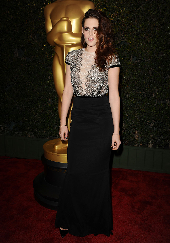 We spotted her classic black pumps peeking out from beneath her floor-length Talbot Runhof gown.