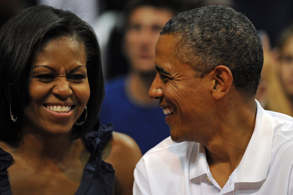 The Obamas laughed together at a pre-Olympic basketball game in Washington DC.