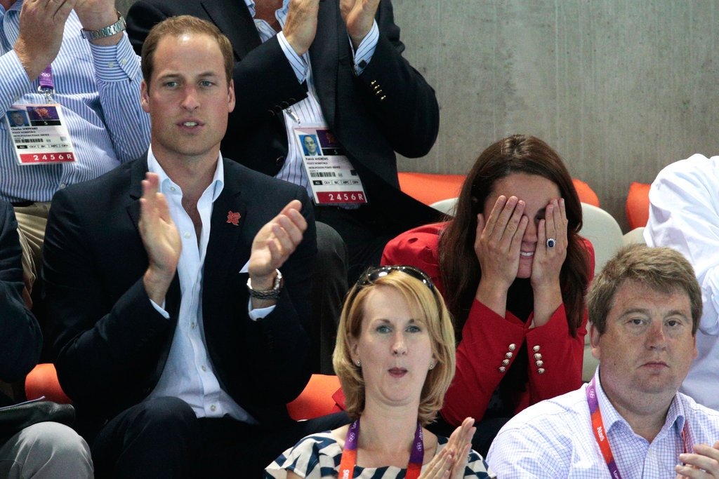 Kate covered her eyes during a swimming event at the 2012 London Olympics.