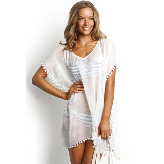 Sheer white + pom poms = get me every time. — Marisa, publisher Kaftan, $54.95, Seafolly