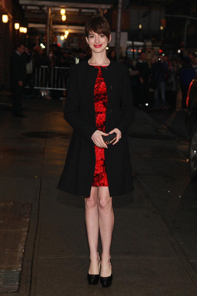 Anne accessorised her look with perfectly ladylike accoutrements, like a box clutch in hand and a classic wool coat.