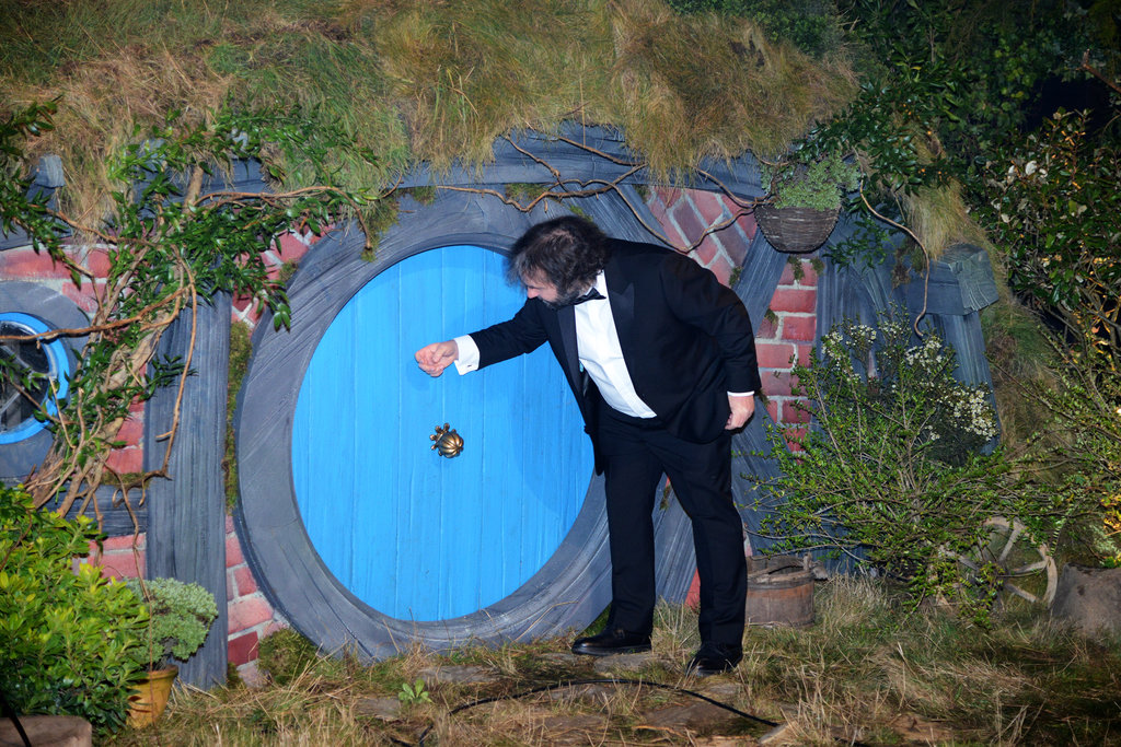 Peter Jackson inspected a faux Hobbit door.