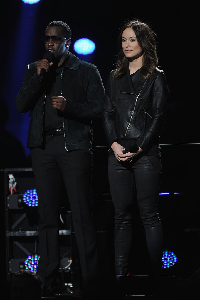 Olivia Wilde and Diddy were on stage at the 12-12-12 Robin Hood Relief Fund concert.
