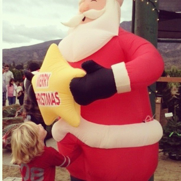 Liam McDermott got a little friendly with the Santa at the Christmas tree farm. Source: Instagram user torianddean