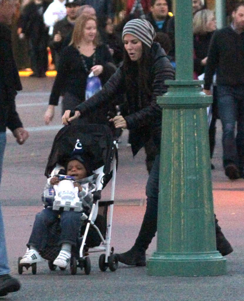 Sandra Bullock pushed Louis in his stoller as he snacked.
