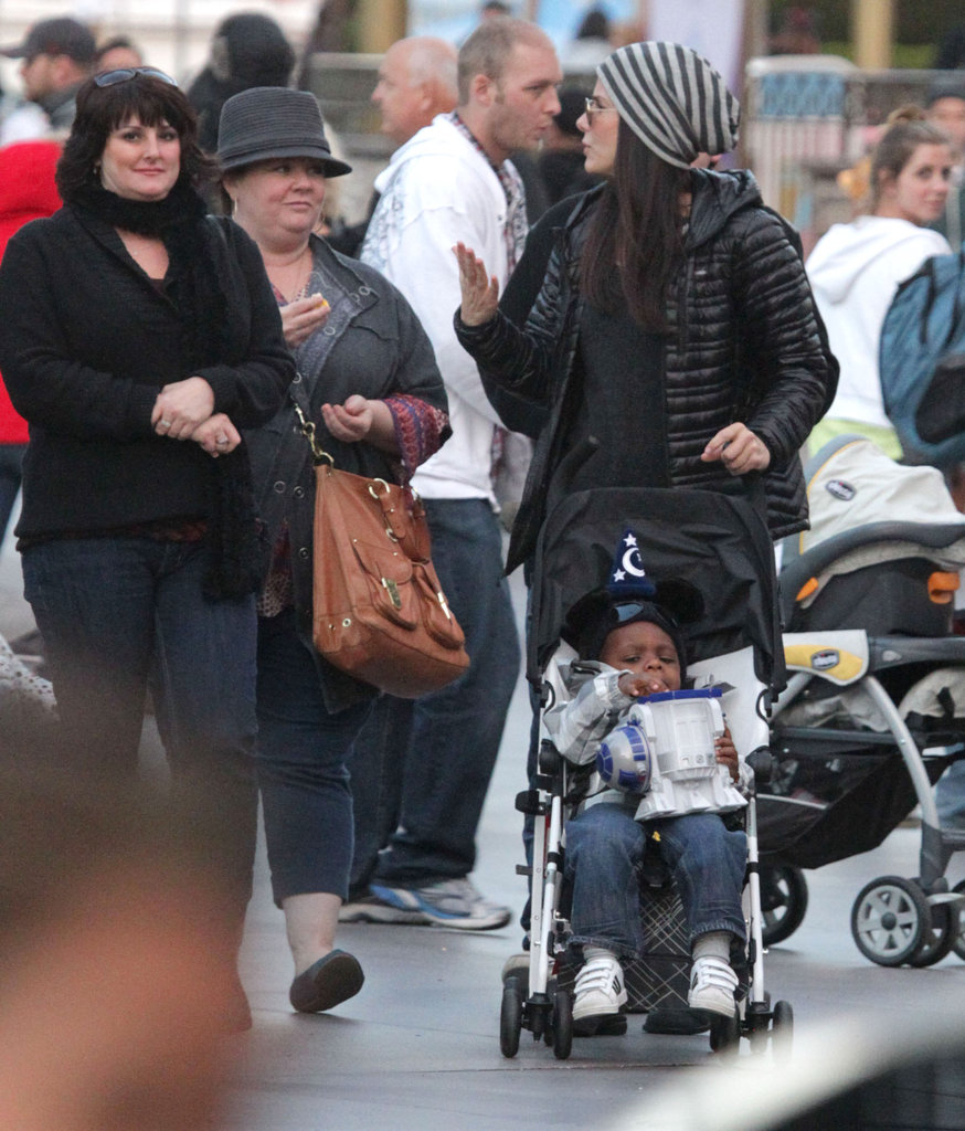 Sandra Bullock chatted with Melissa McCarthy as she pushed little Louis in his stroller around Disneyland.