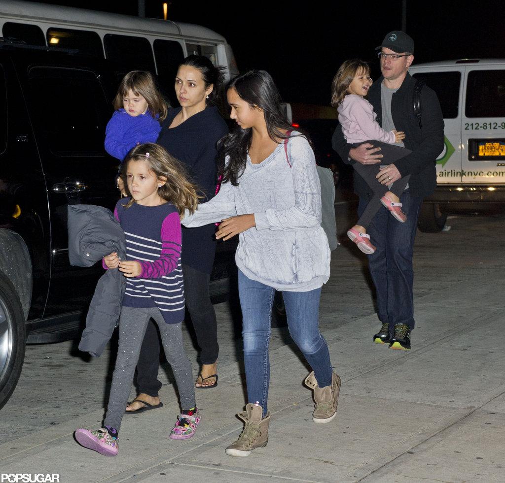 Matt Damon arrived at an airport with Luciana Damon, Isabella Damon, Alexia Barroso, Gia Damon, and Stella Damon.