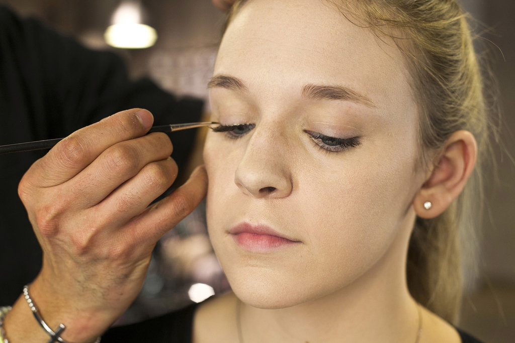 """""""For piece of mind, you can go back with an eyeliner brush if you feel that you've missed some spots,"""" Jennings says. """"You can just dot a few pieces of glue just for reinforcement. So if you see any gaps, you can absolutely fill and adhere the lash."""" In case you're worried about stiffening your brush, just wipe off the excess glue and the rest will come off with soap and warm water. Source: Caroline Voagen Nelson"""