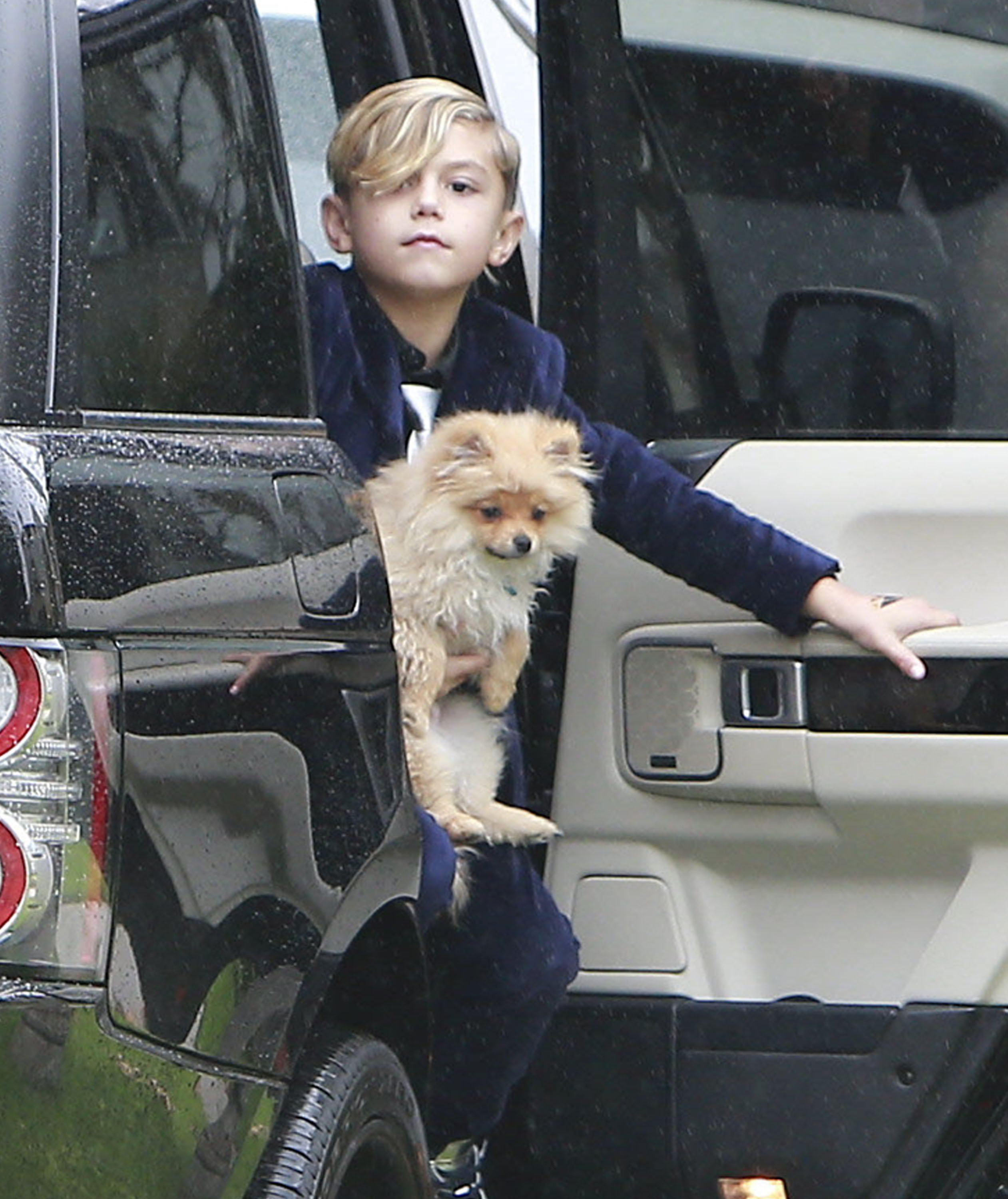 Kingston Rossdale held onto a dog.