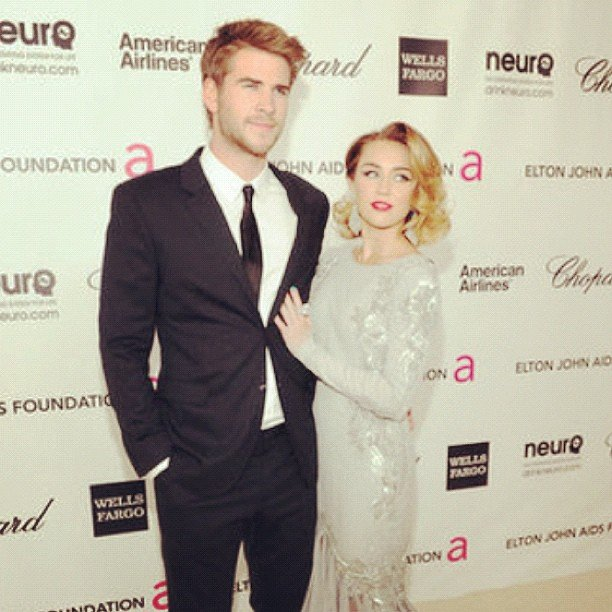 Miley Cyrus and Liam Hemsworth were one good-looking couple at Elton John's annual Oscar viewing party.