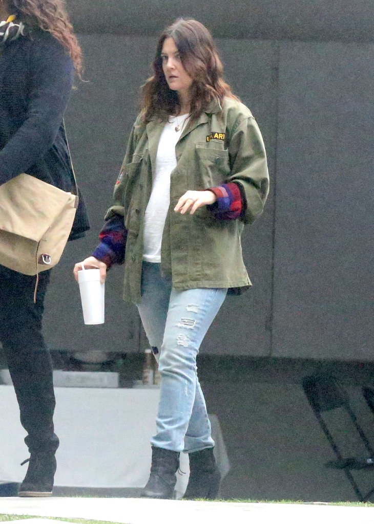Drew Barrymore dressed down in a military coat and jeans.