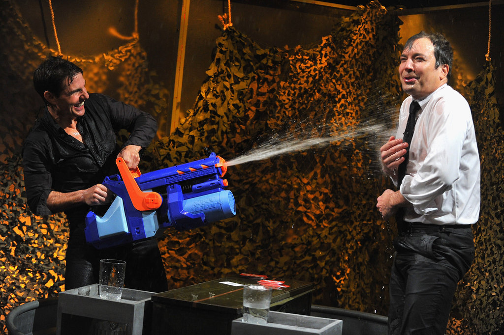 Tom Cruise soaked Jimmy Fallon with his water gun.