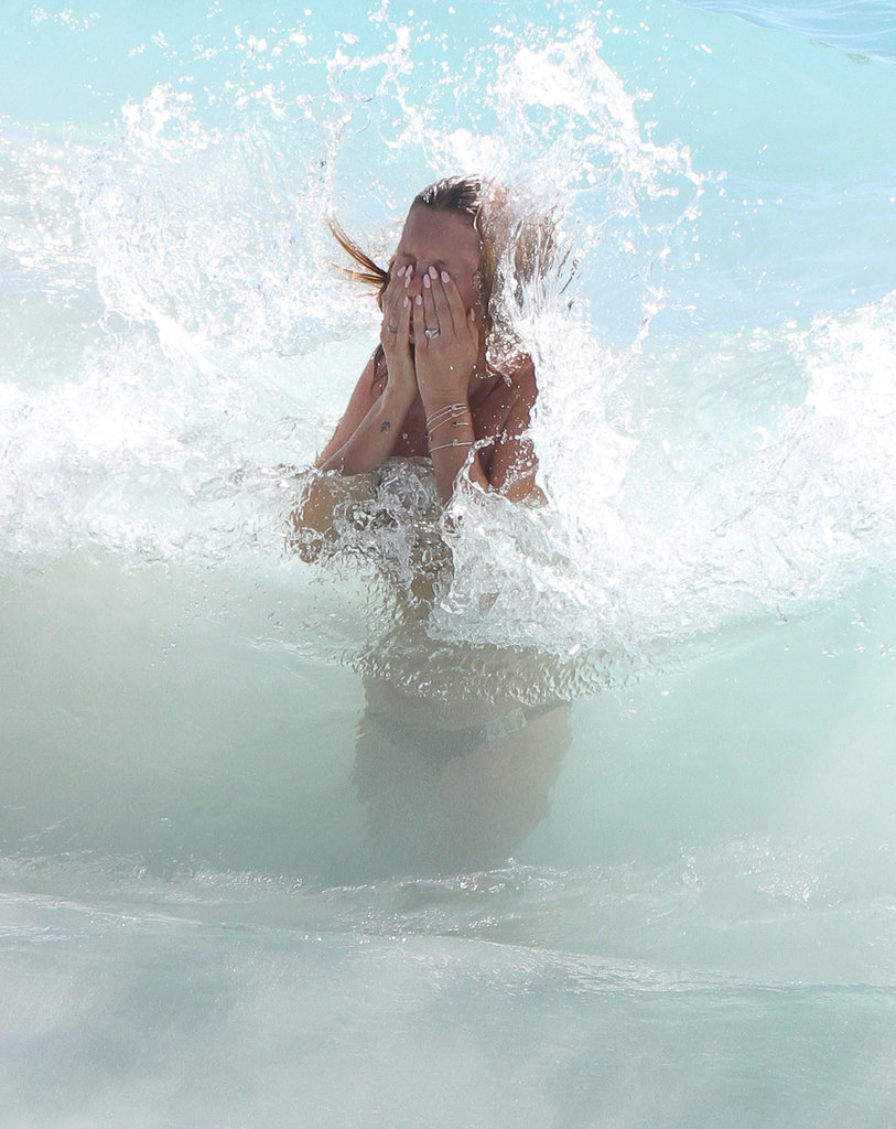 Kate Moss got hit by a wave in the ocean.