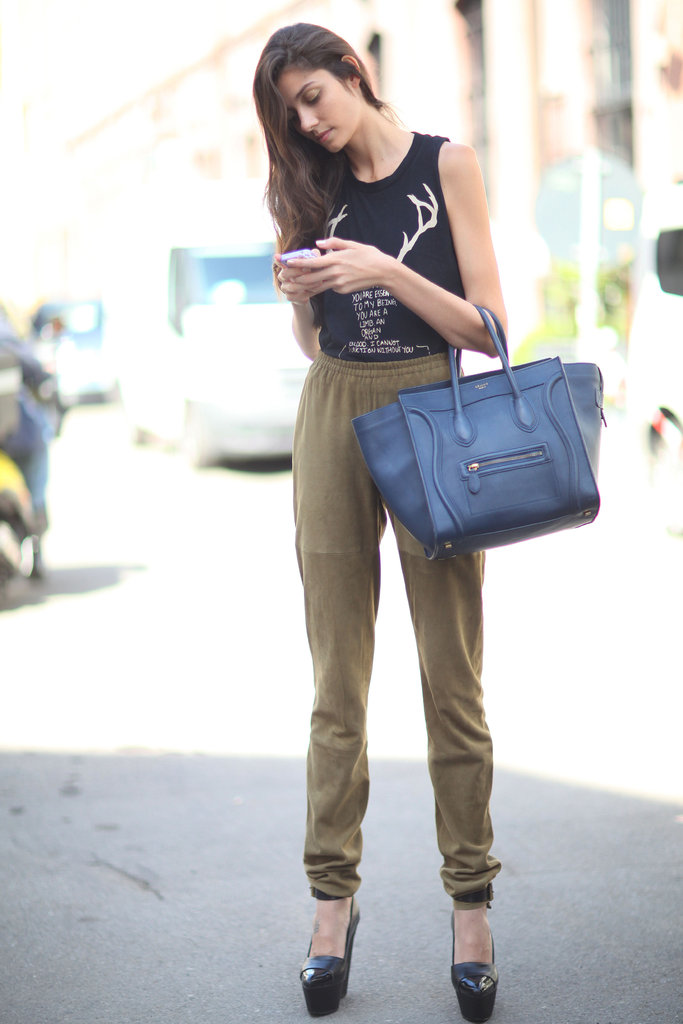 While she read her text messages, we gawked at her Céline Luggage Tote and platform pumps.
