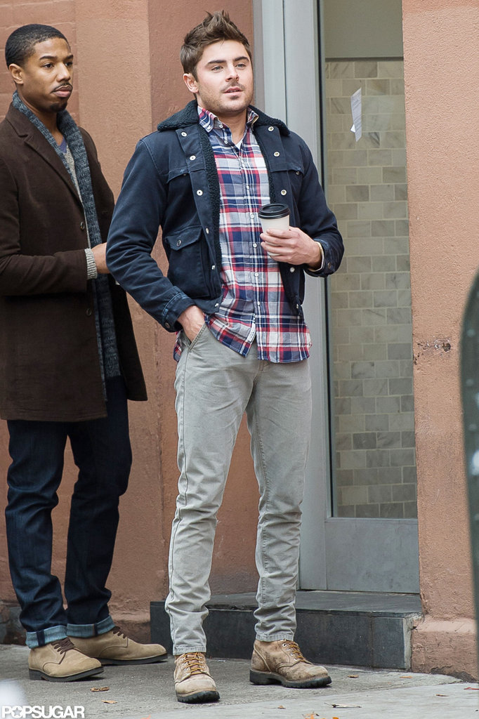 Zac Efron held on to a cup of coffee while filming.