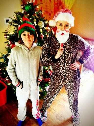 Miley Cyrus wore a Santa mask while dressing up in her Christmas pyjamas.  Source: Twitter user MileyCyrus