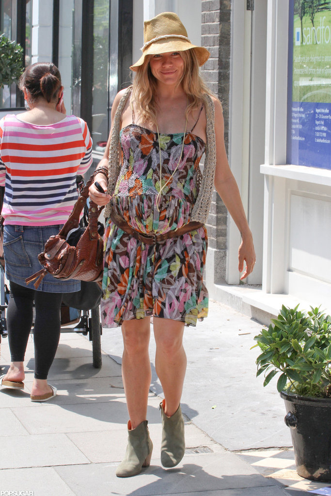Pregnant Sienna channeled the bohemian vibe in a floral sundress in May 2012.