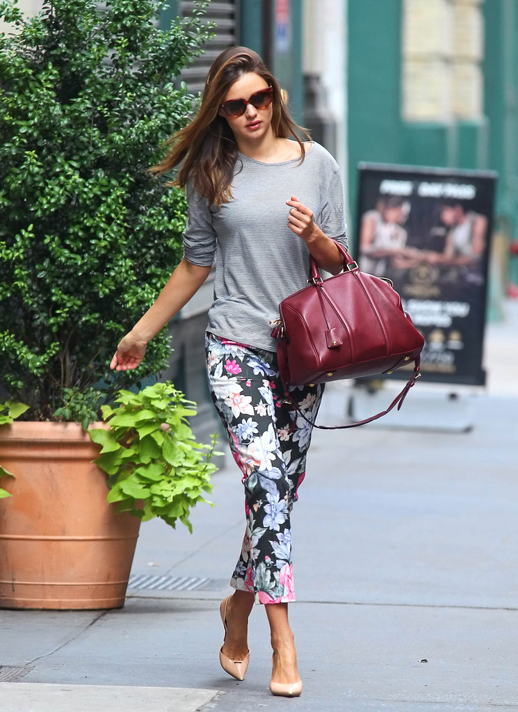 Here's Miranda, proving the sidewalk is really just her catwalk in these floral-print pants and heels.