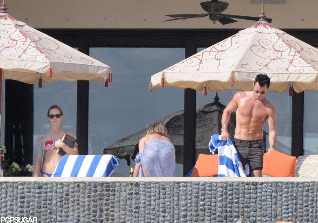 Jennifer Aniston Kisses Justin Poolside During a Bikini-Filled NYE