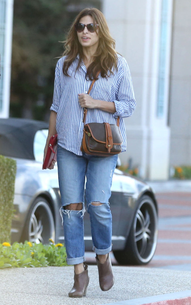 Eva Mendes dressed up her boyfriend jeans with ankle boots and a button-down for a spot-on bit of everyday street style.