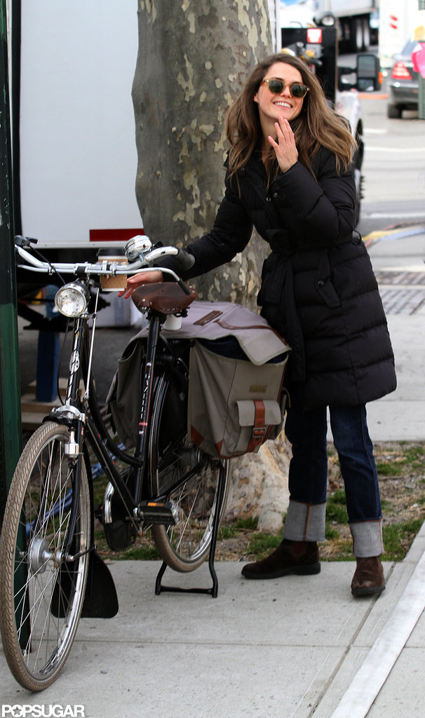 Keri Russell stood next to a bicycle.