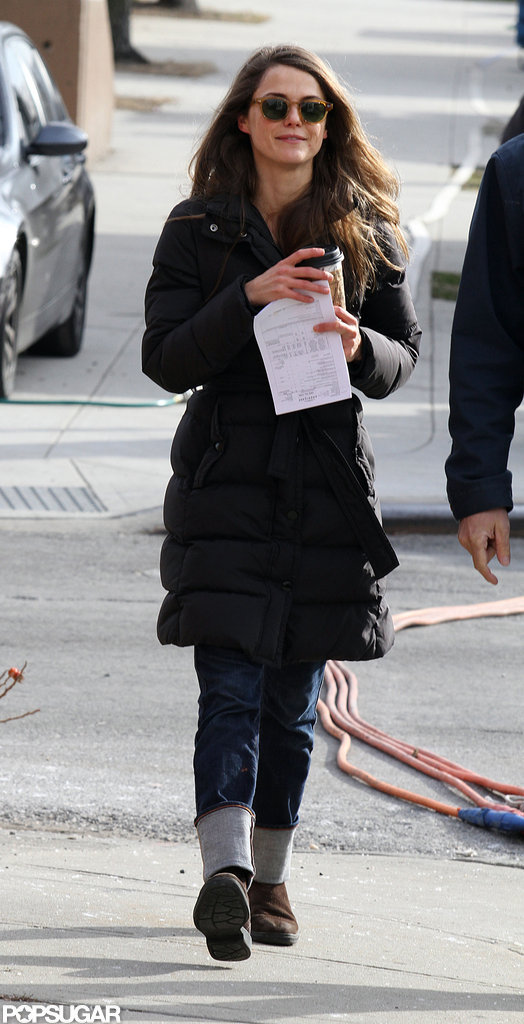 Keri Russell carried her coffee.