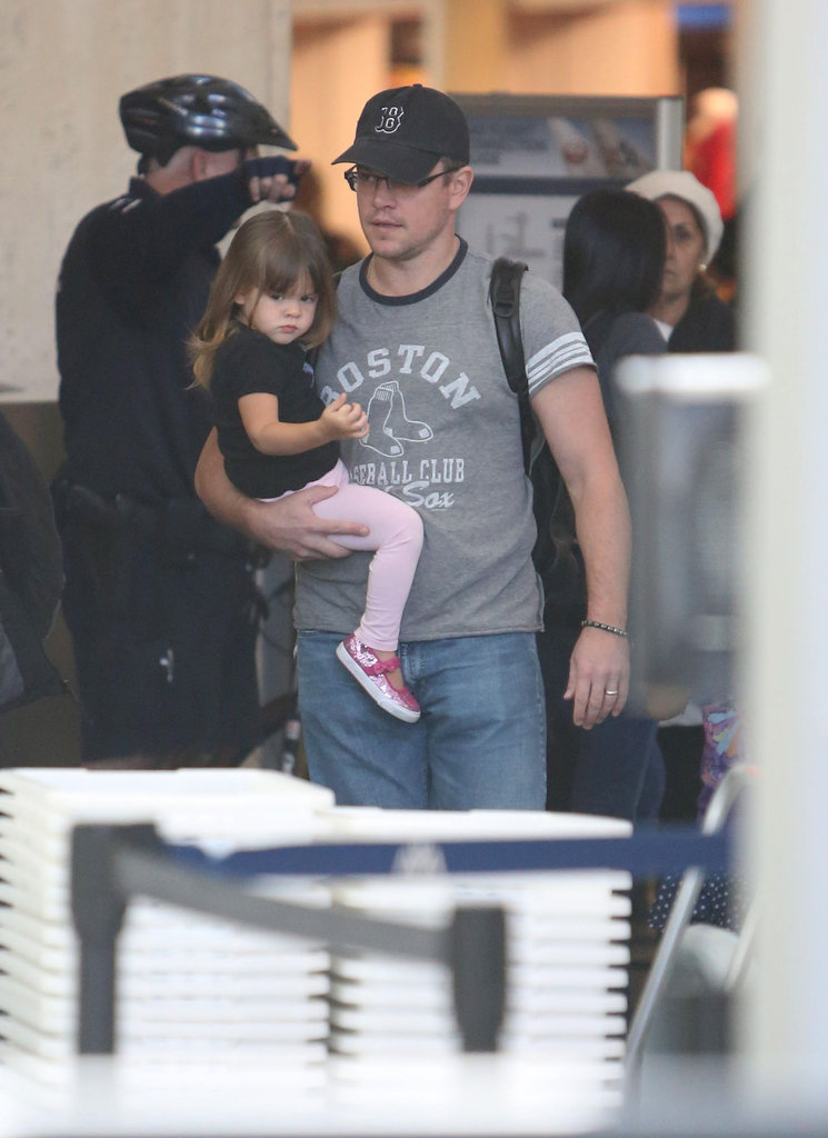 Matt Damon carried his 2-year-old daughter, Stella, through the airport in LA.