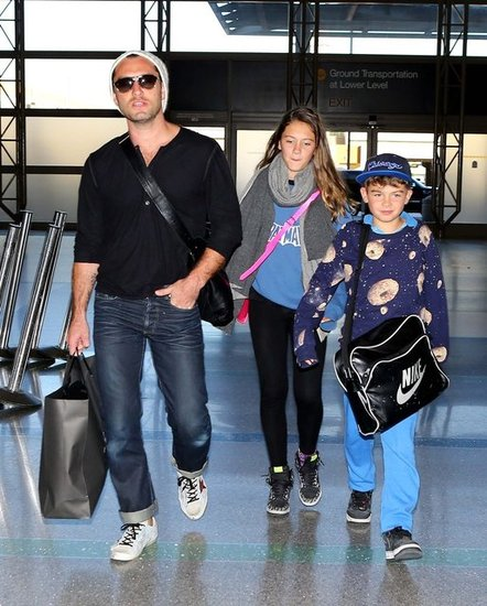Jude Law made his way through an LAX terminal.