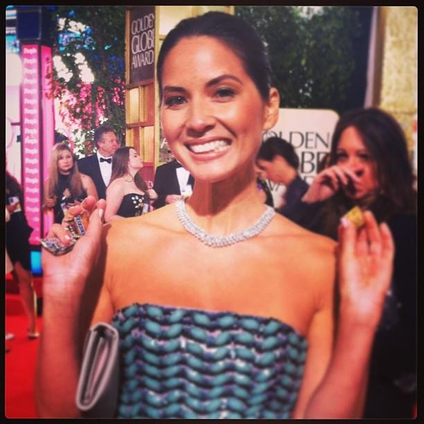 Olivia Munn kept chocolate in her clutch at the Globes. Source: Twitter user InStyle